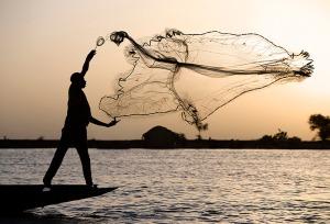 Bozo fisherman using a net on the River Niger, Mopti, Mali