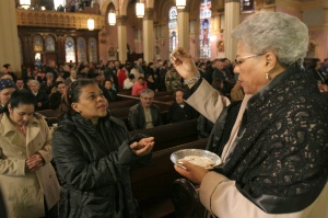 WOMAN DISTRIBUTES COMMUNION DURING 2008 MASS IN NEW YORK